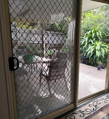 door that needs glass repair in brisbane